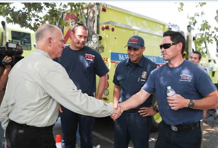 "FM/PM Jeff Collins shaking hands with Gov. Jerry Brown while at the ""Rim Fire."""