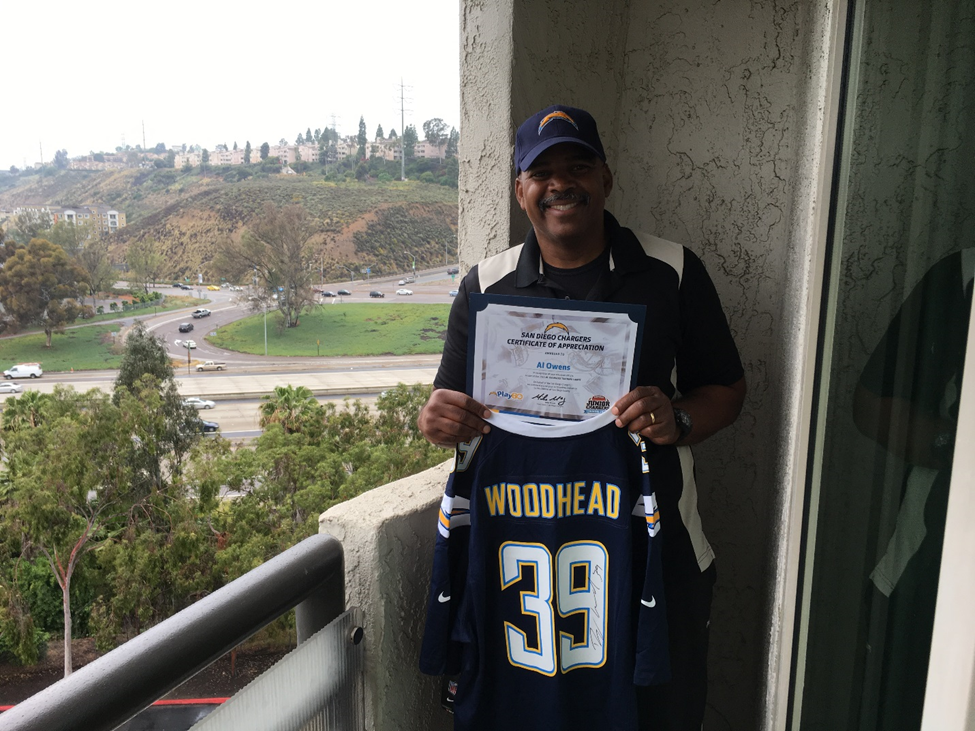 Lieutenant Al Owens with an autographed Chargers jersey