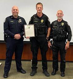 Officer Trent Aronson receives a Life Saving Citation Award